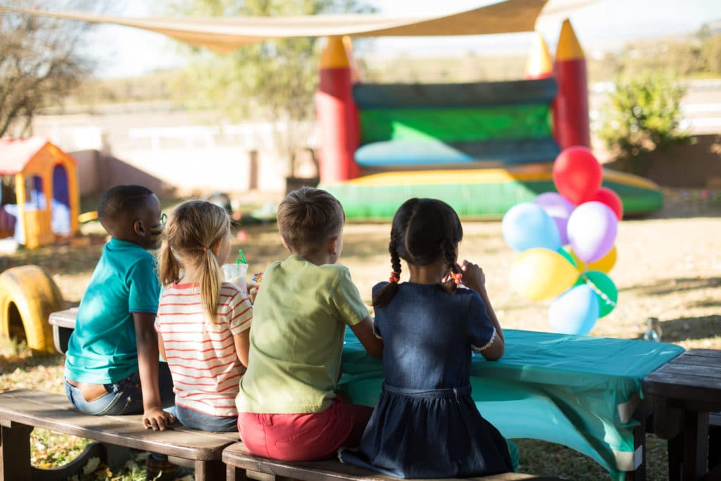 Children sitting on bench at park
