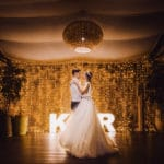 Couple dancing on their wedding day at night