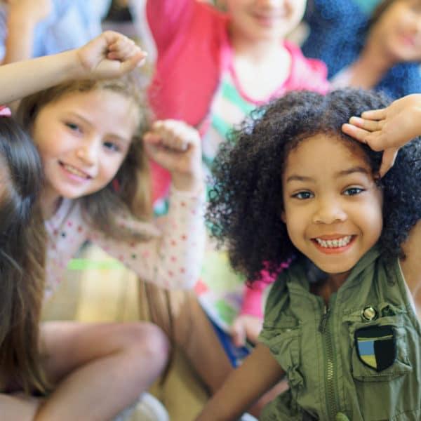 Happy diverse young school kids